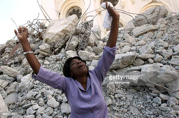 Haitian woman grieves outside the collapsed Notre Dame Cathedral following a funeral Mass for Monsignor Joseph Serge Miot, Archbishop of...