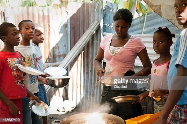 Haitian woman is distributing food