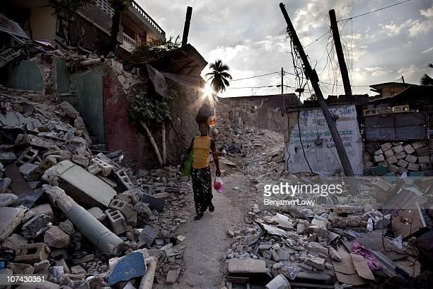 Haitian woman walks through the remains of the hard hit Carrefour Feuilles neighborhood of Port au Prince Haiti on February 6 2010. Haiti was struck...