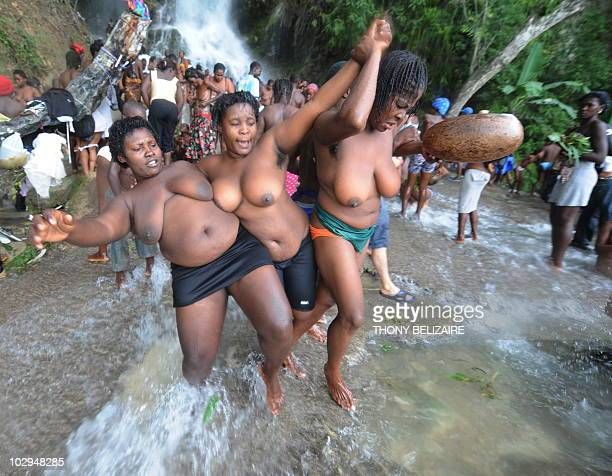 Haitian women in a trance dance in the waterfall on July 16 2010 during the annual pilgrimage to Saut d'Eau 68km north of PortauPrince Haitian...