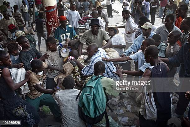 Haitians are seen fighting as they are looting in the city center on January 24 2010 in Port Au Prince Haiti As many as 200000 people died on January...