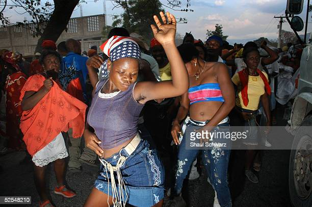Haitians attend a rara march through the city March 26 2005 in Gonaives Haiti Every year during the week of Good Friday rara bands parade through...