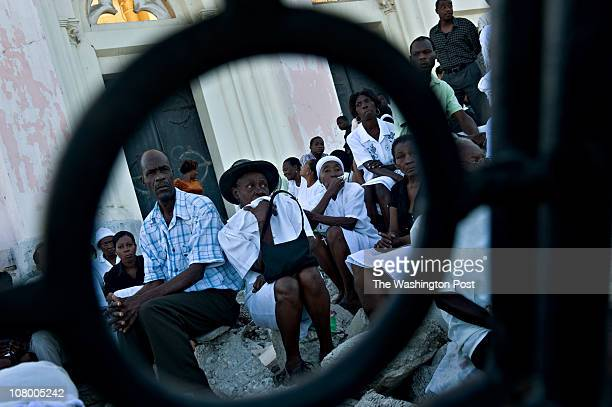 Haitians attend prayer services at the National Cathedral to commemorate the one year anniversary of the Jan 12 devastating earthquake in...