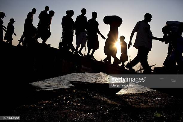 Haitians board the packed boat to Jeremi, a province unaffected by the earthquake, from a polluted and chaotic port in Port au Prince on February 4...