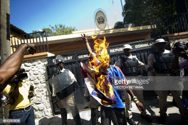 Haitians burn a flag of the Dominican Republic in front to the Dominican Consulate General in PortauPrince on February 25 2015 Thousands of Haitians...