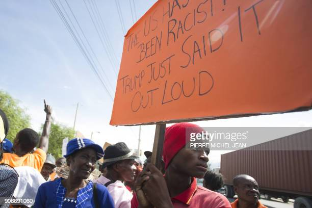 Haitians gather in front of the US Embassy in PortauPrince during a sitin to express their dissatisfaction with the recent remarks that have been...