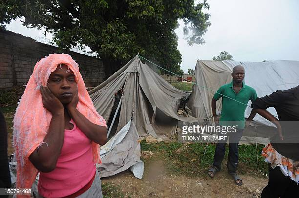 Haitians in a tent camp views damages August 25 2012 as Tropical Storm Isaac barrelled through PortAuPrince Forecasters earlier said Isaac was near...