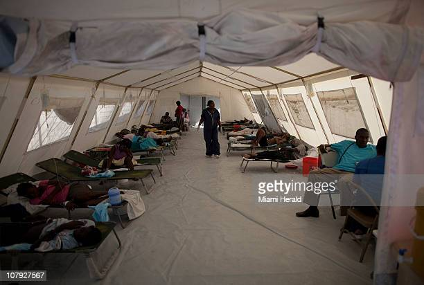 Haitians infected with cholera receive treatment in a clinic set up by the International Red Cross in PortauPrince Haiti January 4 2011
