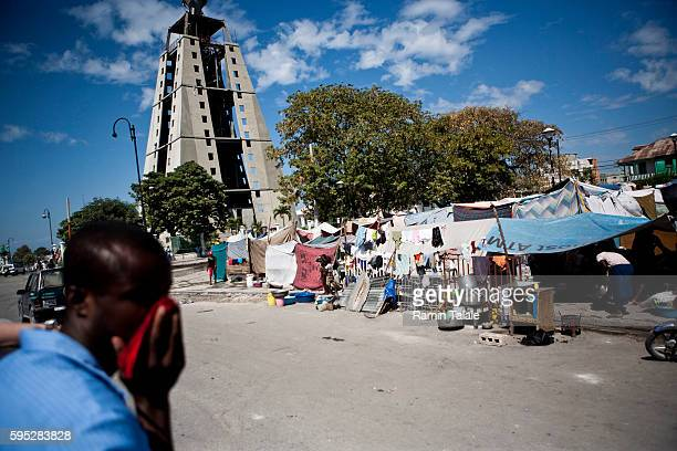 Haitians live in tents in a park in the downtown area of PortauPrince on January 27 2010 The January 12 earthquake that hit Haiti killed about 170000...