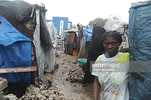 Haitians living in a tent camp wait out Tropical Storm Isaac as it barrels through PortAuPrince August 25 2012 Forecasters earlier said Isaac was...