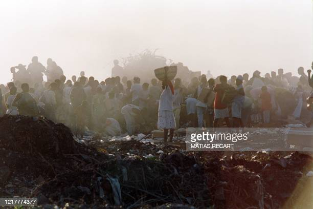 Haitians look for valuables and food at the Port-au-Prince dump on October 18, 1994.