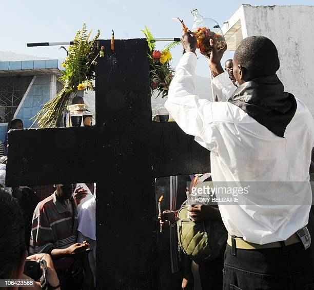 Haitians pay homage on All Saints' Day at the municipal cemetery in Port-au-Prince, Haiti, on November 1, 2010. Haitians celebrate the Catholic All...