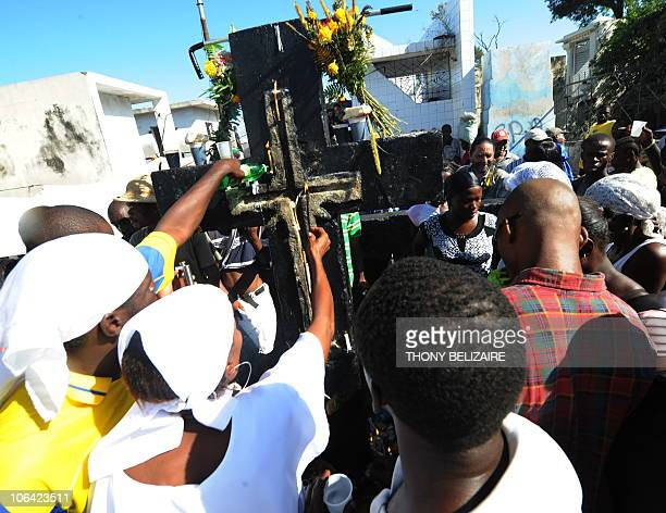 Haitians pay homage to relatives on All Saints' Day at the municipal cemetery in Port-au-Prince, Haiti, on November 1, 2010. Haitians celebrate the...