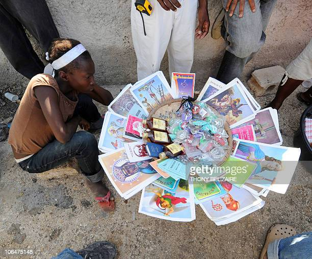 Haitians pay homage to relatives with drink and religious items on All Saints' Day at the municipal cemetery in Port-au-Prince, Haiti, on November 1,...