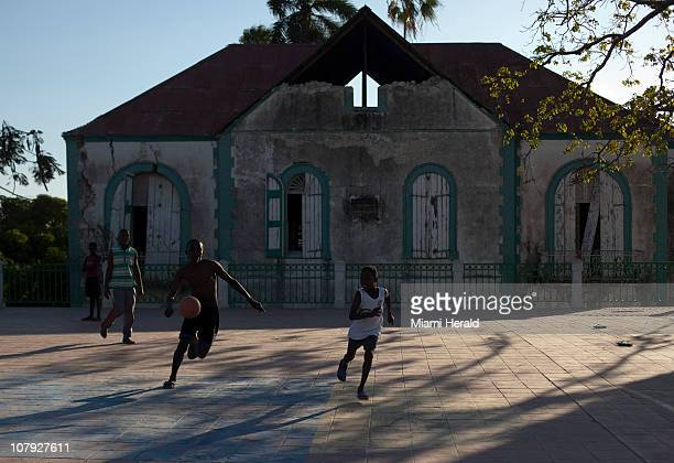 Haitians play ball next to a colonial building at the park in Jacmel Haiti January 3 2011