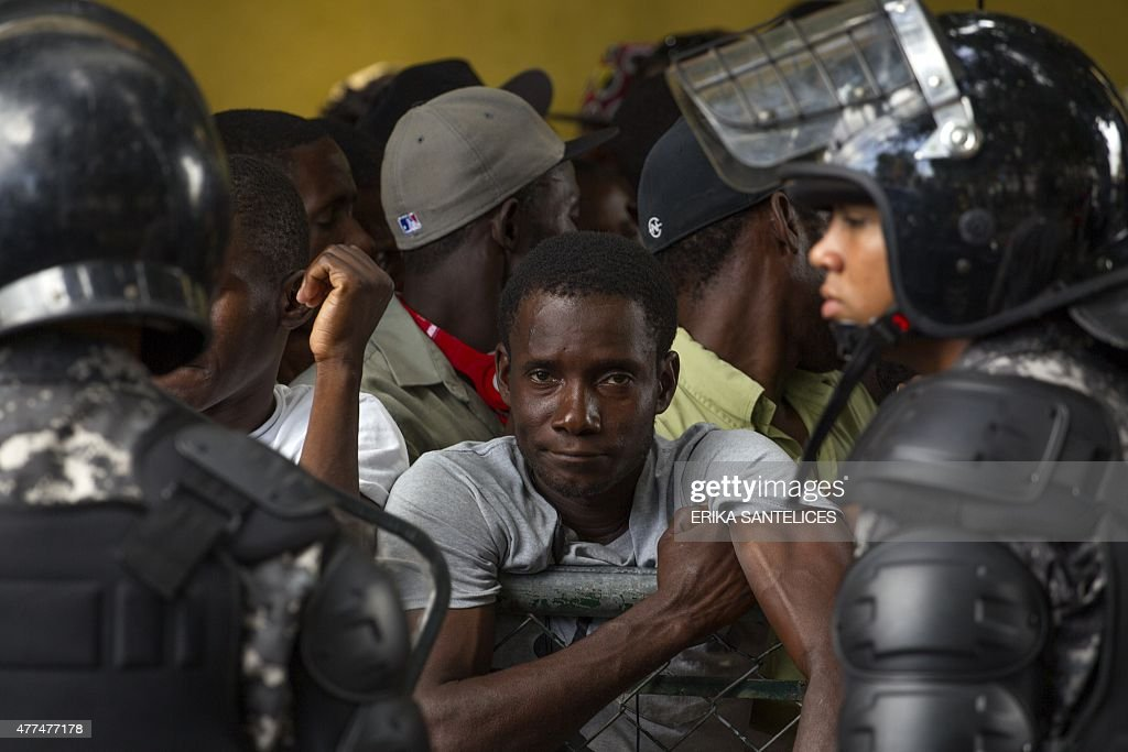 Haitians queue up to legalize their status at the Interior Ministry in Santo Domingo, on June 17, 2015. Tens of thousands of people are facing deportations as a deadline for foreigners, most of them being Haitians, to legalize their status as undocumented alien is due to expire midnight.