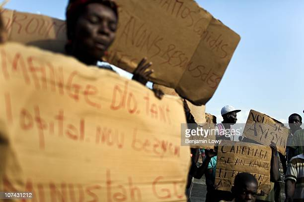 Haitians stage a protest along the Airport Road demanding more tents and food aid in Port au Prince on February 11 2010. Haiti was struck by a...