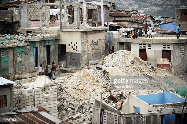Haitians survive in the rubble of Fort Nacional November 3 2010 in Port au Prince Haiti The January 12th earthquake lay Fort Nacional once a bustling...
