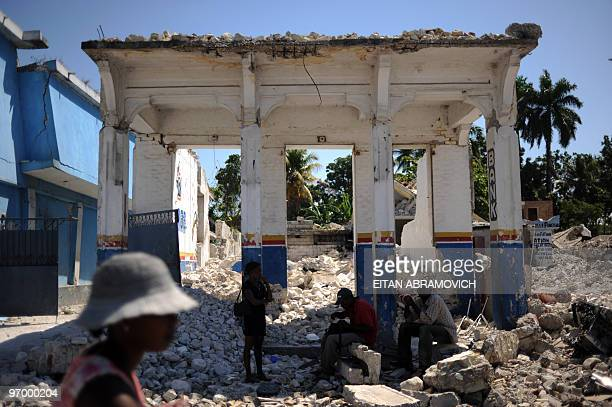 Haitians take cover from the sun under a devastated building in the coastal city of Leogane on February 23 2010 The town of Leogane an hour outside...