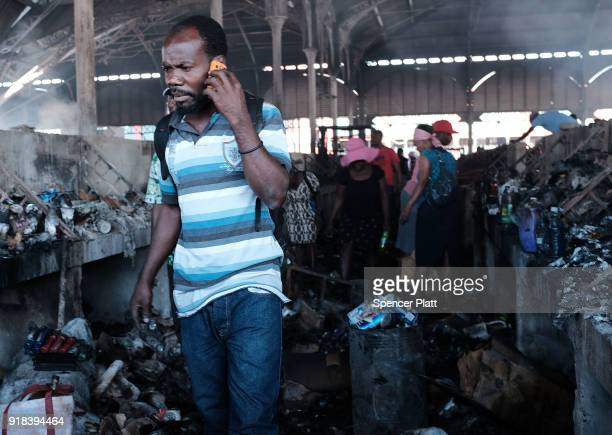 Haitians walk inside of PortauPrince's destroyed historic Iron Market after a fire yesterday on February 14 2018 in PortauPrince Haiti Hundreds of...