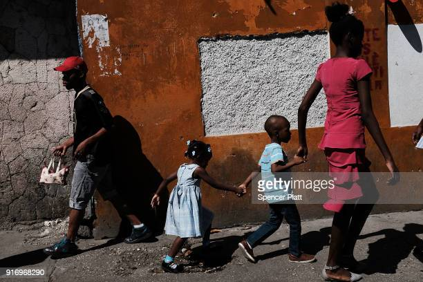 PRINCE HAITI FEBRUARY Haitians walk through Port au Prince as the city prepares for Carnival which is set to start later in the day on February 10...