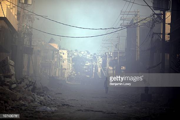 Haitians wander through the smoking remains of the earthquake damaged remains of downtown Port au Prince, Haiti. On January 12, 2010 Haiti was struck...
