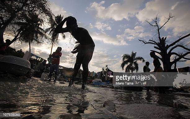 Haitians wash clothes in a stream January 8 2011 in PortauPrince Haiti Residents say the stream dried up immediately following the deadly January 12...