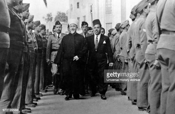 Haj Amin alHusseini The Grand Mufti of Jerusalem and head of the Arab Higher Committee reviewing a guard of honorat a village in Galilee on 23 April...