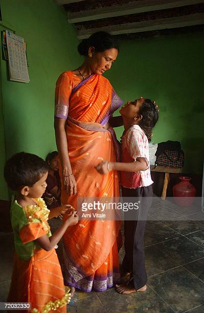 Hajamma a jogini woman who fought the system and married a man gets her child and a neighbors child ready in the morning in this photo taken on...
