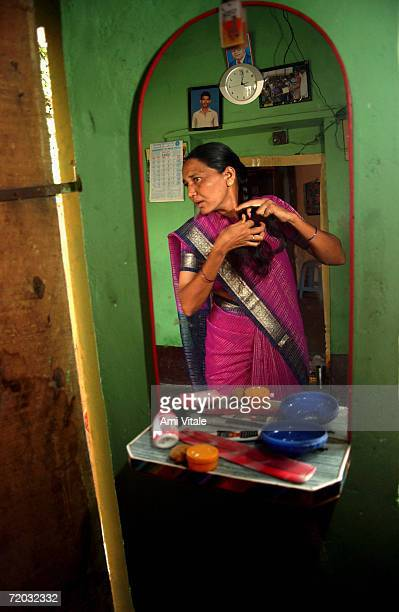 Hajamma a jogini woman who fought the system and married a man gets ready in the morning in this photo taken on August 21 2005 in Mehbubnagar in...