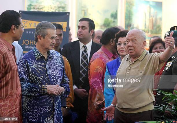Haji Abdul Ghani Othman chief minister of Johor left and Abdullah Ahmad badawi prime minister of Malaysia second left listen as AlMutawakkil Alallah...