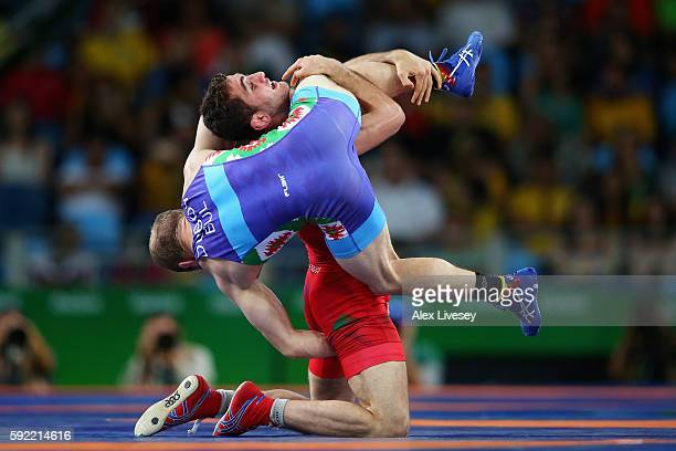 Haji Aliyev of Azerbaijan competes against Vladimir Vladimirov Dubov of Bulgaria during the Men's 57kg Bronze Medal Wrestling match on Day 14 of the...