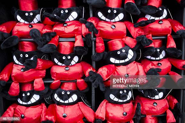 Haji Firouz dolls are on display for Noruz the Persian new year celebrations at Tajrish square market in Tehran on March 20 on the eve of beginning...