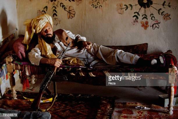 Haji Gol Mohammad poses for a portrait on July 2004 in Petawgai Afghanistan