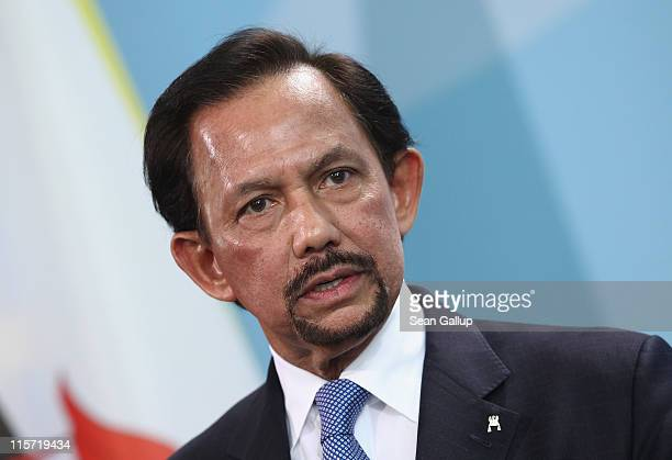 Haji Hassanal Bolkiah the Sultan of Brunei gives a statement to the media following talks with German Chancellor Angela Merkel at the Cahncellery on...