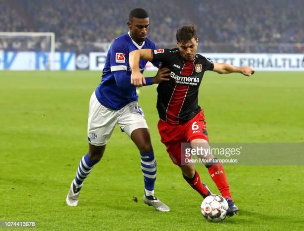 Haji Wright of FC Schalke 04 battles for possession with Aleksander Dragovic of Bayer 04 Leverkusen during the Bundesliga match between FC Schalke 04...