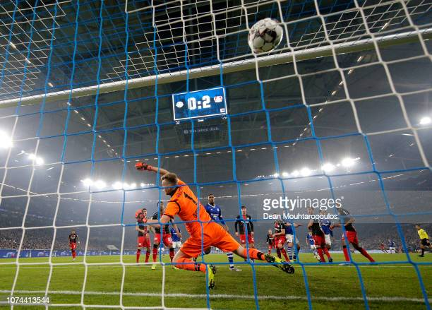 Haji Wright of FC Schalke 04 scores his team's first goal past Lukás Hrádecky of Bayer 04 Leverkusen during the Bundesliga match between FC Schalke...