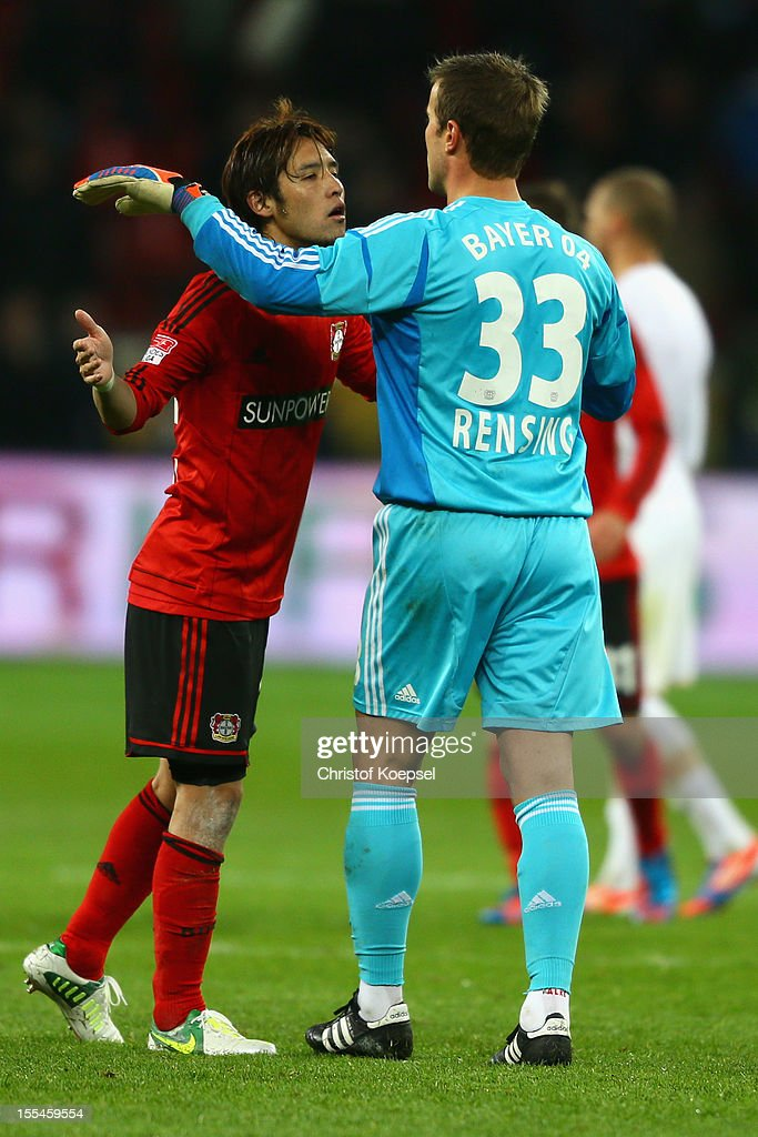 Hajime Hosogai and Michael Rensing of Leverkusen celebrate after the Bundesliga match between Bayer 04 Leverkusen and Fortuna Duesseldorf at BayArena on November 4, 2012 in Leverkusen, Germany. The match between Leverkusen and Duesseldorf ended 3-2.