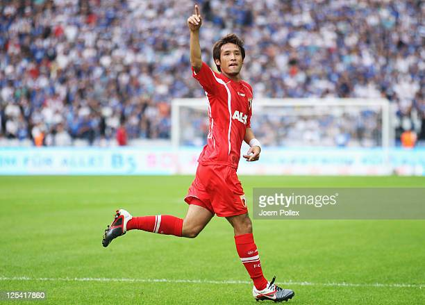 Hajime Hosogai of Augsburg celebrates after scoring his team's first goal during the Bundesliga match between Hertha BSC Berlin and FC Augsburg at...
