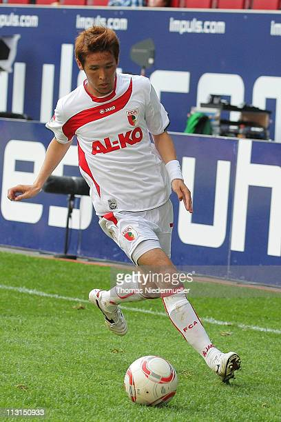 Hajime Hosogai of Augsburg runs with the ball during the Second Bundesliga match between FC Augsburg and Alemannia Aachen at the Impuls Arena on...