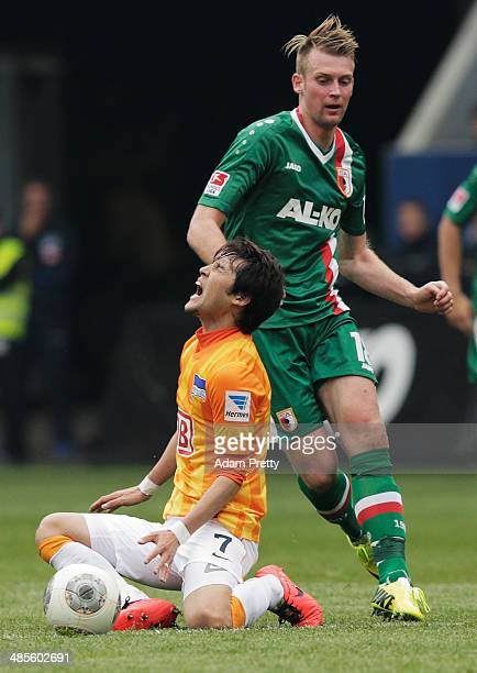 Hajime Hosogai of Hertha screams out in pain during the Bundesliga match between FC Augsburg and Hertha BSC at SGL Arena on April 19 2014 in Augsburg...
