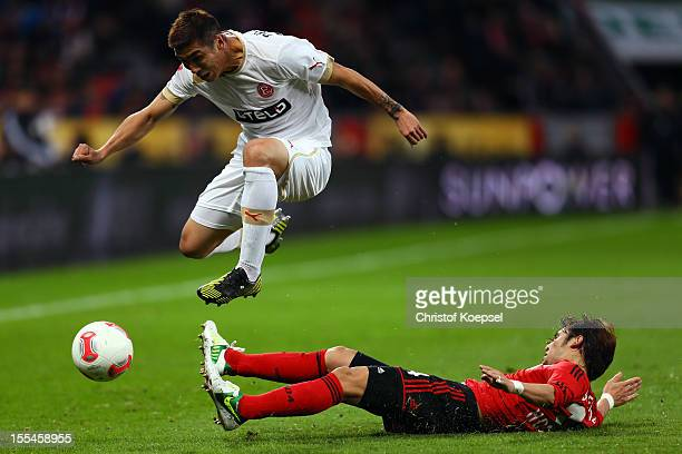 Hajime Hosogai of Leverkusen challenges Du-Ri Cha of Duesseldorf during the Bundesliga match between Bayer 04 Leverkusen and Fortuna Duesseldorf at...