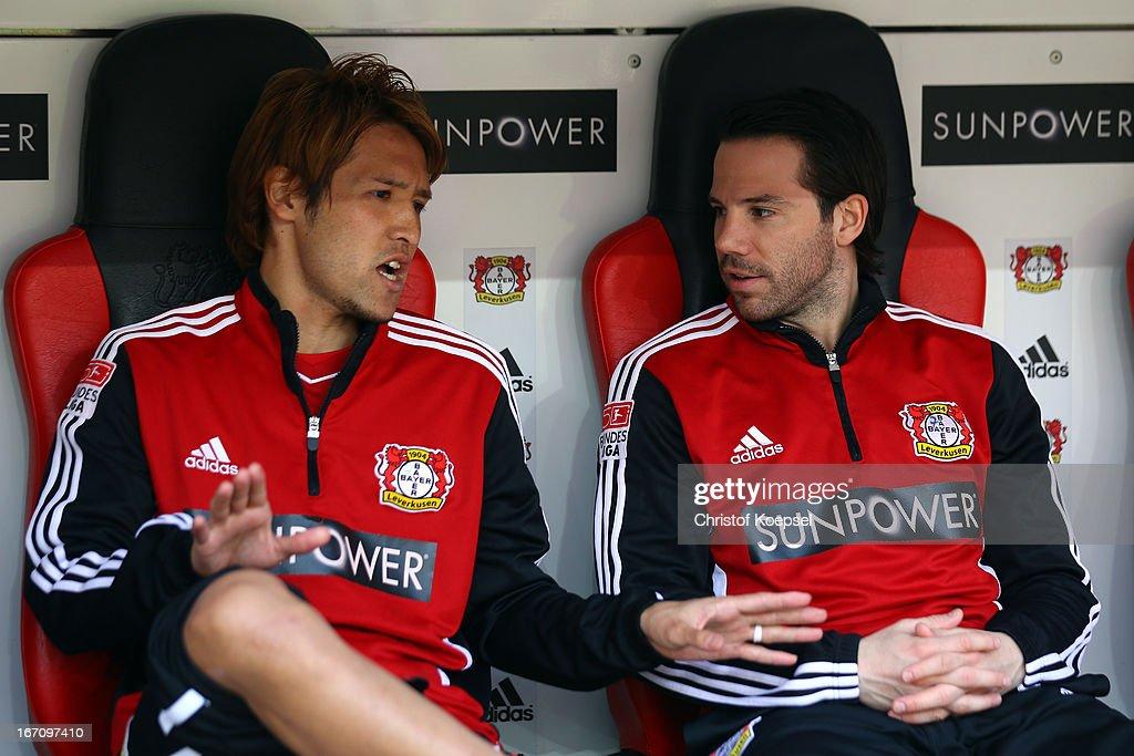 Hajime Hosogai of Leverkusen talks to Gonzalo Castro on the bench during the Bundesliga match between Bayer 04 Leverkusen and TSG 1899 Hoffenheim at BayArena on April 20, 2013 in Leverkusen, Germany.