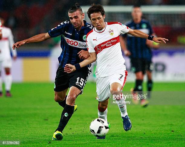 Hajime Hosogai of VfB Stuttgart is tackled by Serdar Dursun of SpVgg Greuther Fuerth before the Second Bundesliga match between VfB Stuttgart and...