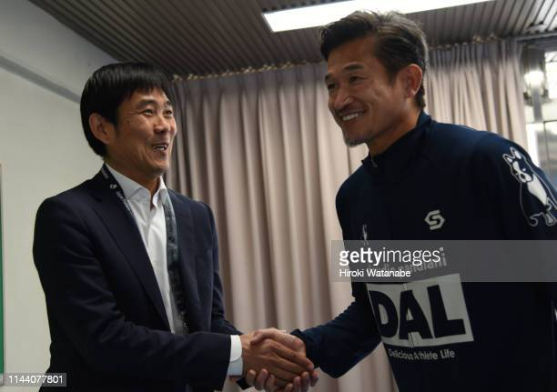 Hajime Moriyasu, coach of Japan and Kazuyoshi Miura of Yokohama FC shake hands prior to the J.League J2 match between Yokohama FC and JEF United...