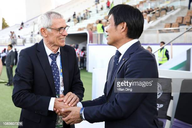 Hajime Moriyasu head coach of Japan shakes hands with Hector Cuper head coach of Uzbekistan during the AFC Asian Cup Group F match between Japan and...