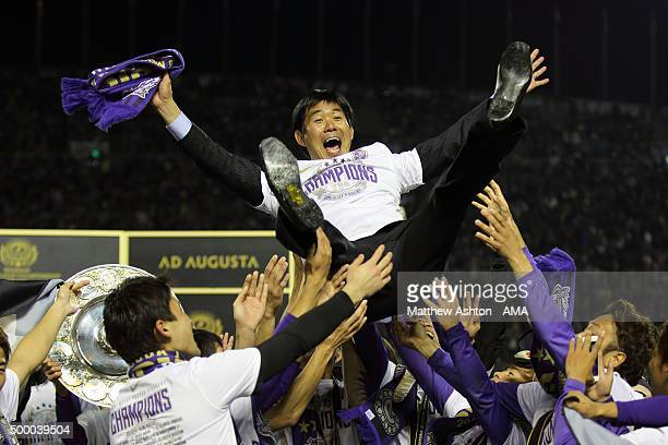 Hajime Moriyasu the head coach / manager of Sanfrecce Hiroshima is thrown into the air as Sanfrecce Hiroshima celebrate winning the JLeague 2015...