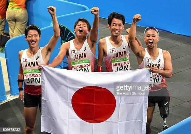 Hajimu Ashida Keita Sato Tomoki Tagawa and Atsushi Yamamoto of Japan celebrate winning the bronze medal in the Men's 4x100m Relay T4247 Final duirng...