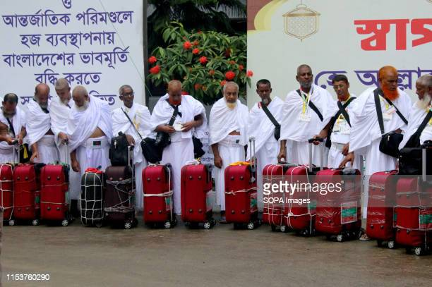 Hajj pilgrims in a queue at the Hazrat Shahjalal International Airport in Dhaka This year's Hajj flight began today as an aircraft of Biman...