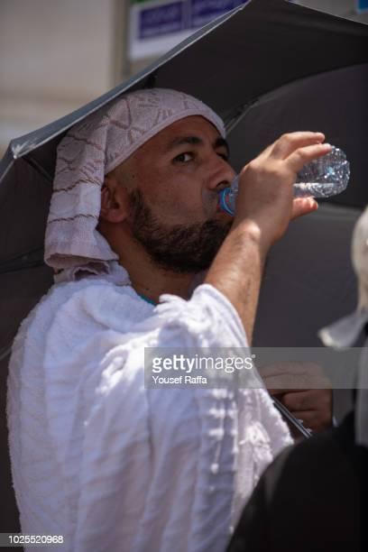 Hajji drinking water during hajj